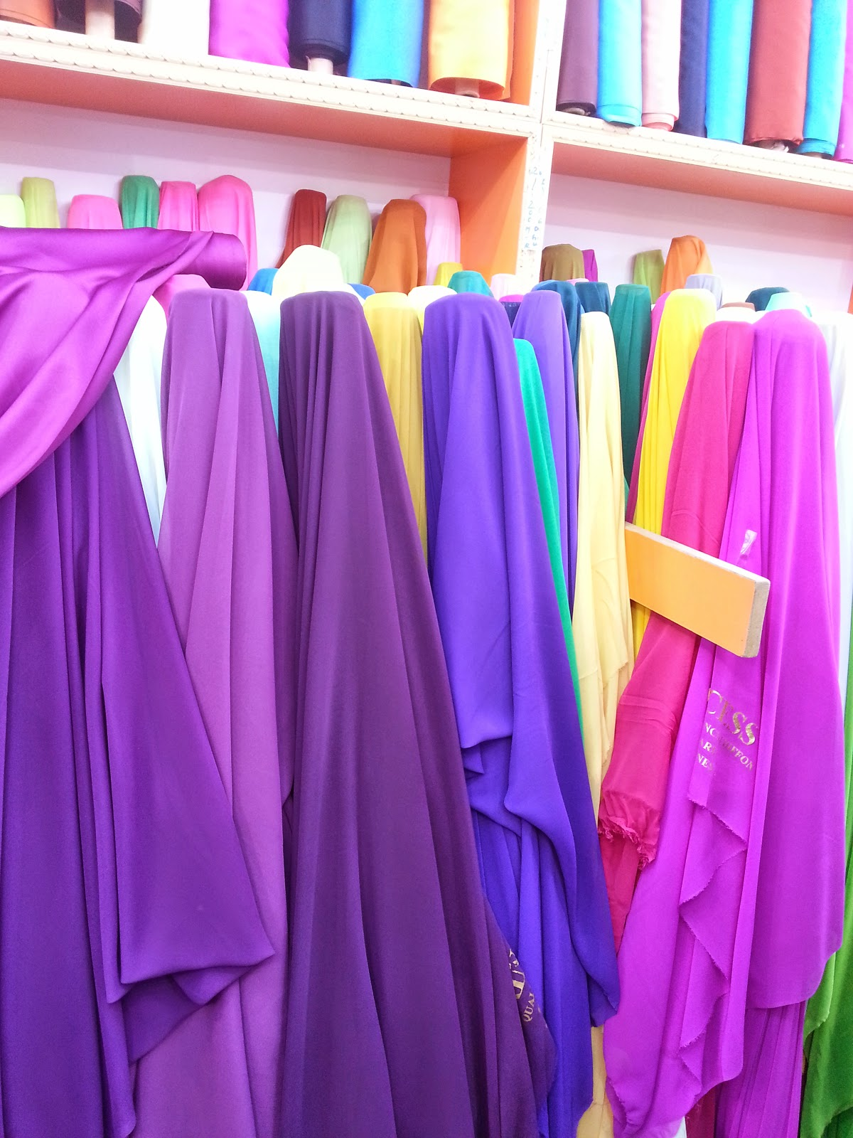 fabric shops muscat