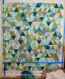 In progress triangle quilt on the design wall