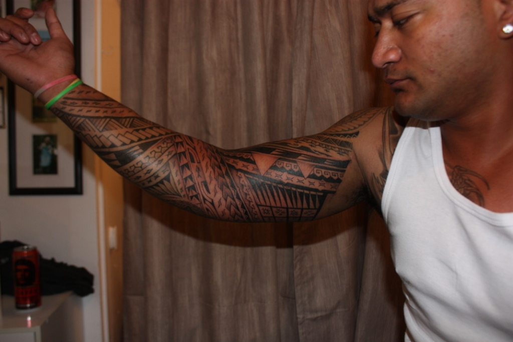 arm chest tattoo.chest to arm tattoo