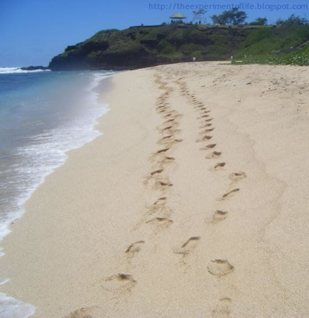 sand footprints on the beach at Gris Gris, Mauritius