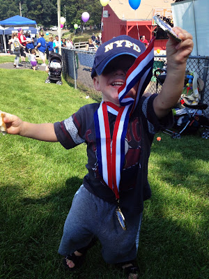 toddler with medals