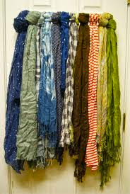 use a towel bar to organize multiple scarves