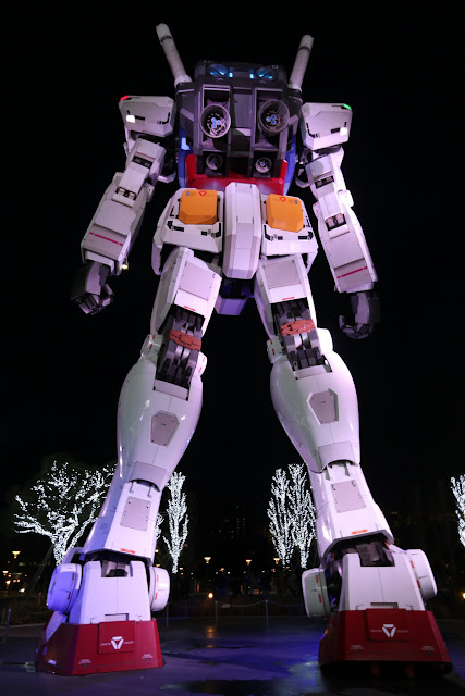 The detailed back view of the components of the giant Gundam robot in front of The Diver City Plaza at Odaiba Tokyo Bay in Japan