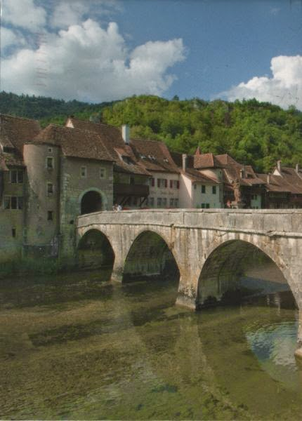 Medieval bridge over river to old town houses