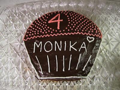 decorated birthday cake shaped like cupcake