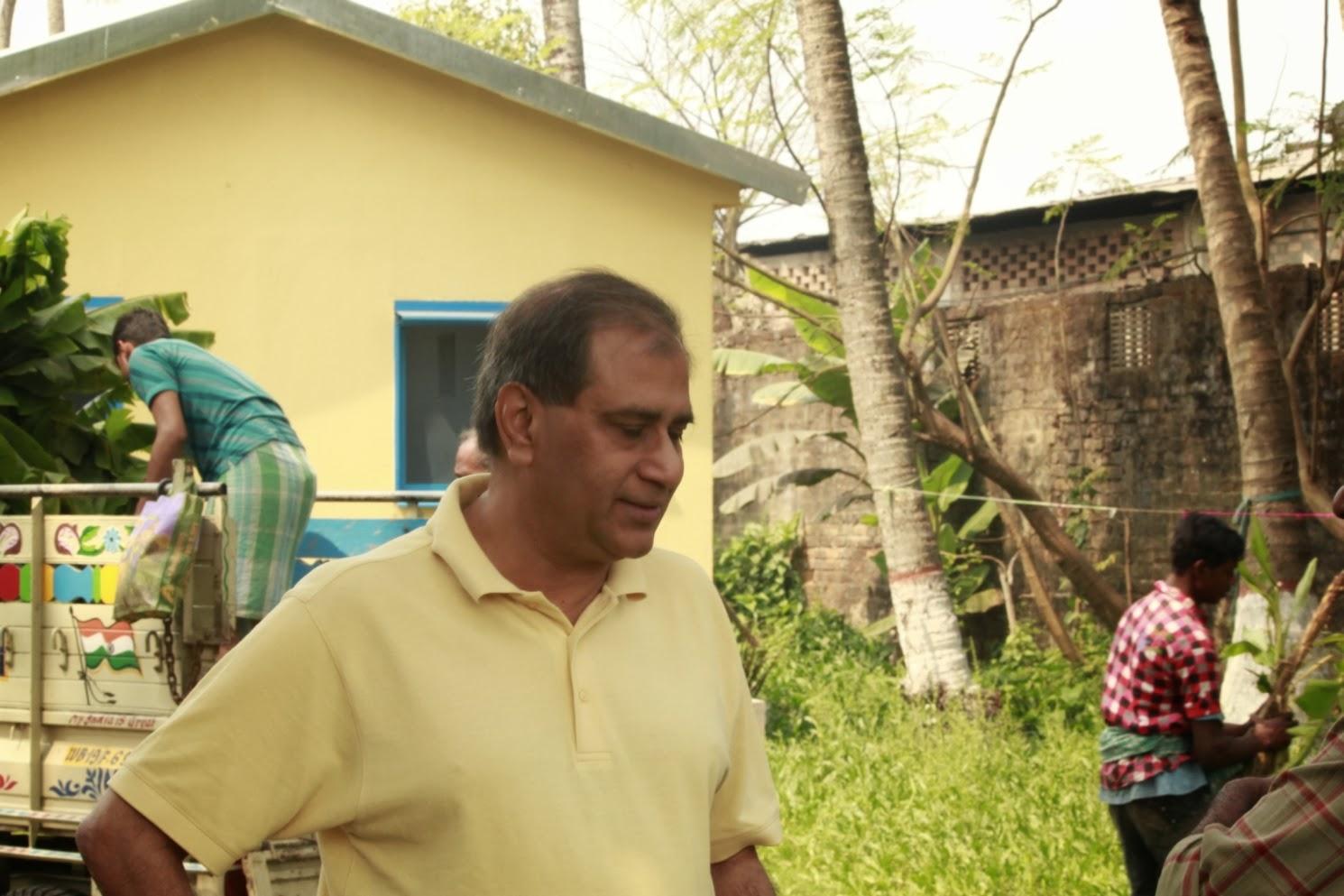 Sandip Bhatia planting a Guava tree at SPCI Kolkata India, planted for his wife Vinita Bhatia