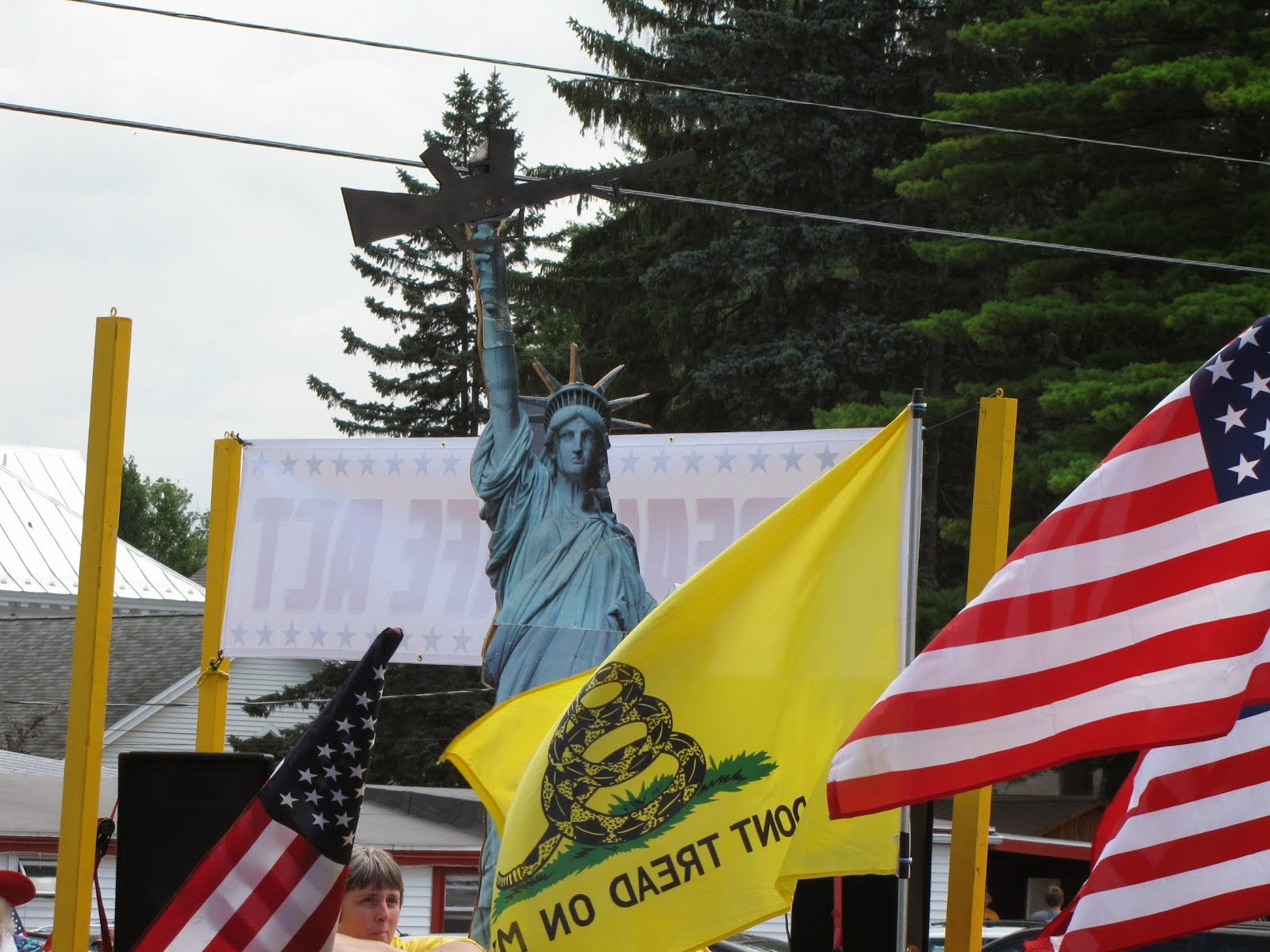 Lady Liberty Holding an Assault Rifle on Anti-SAFE Act Float