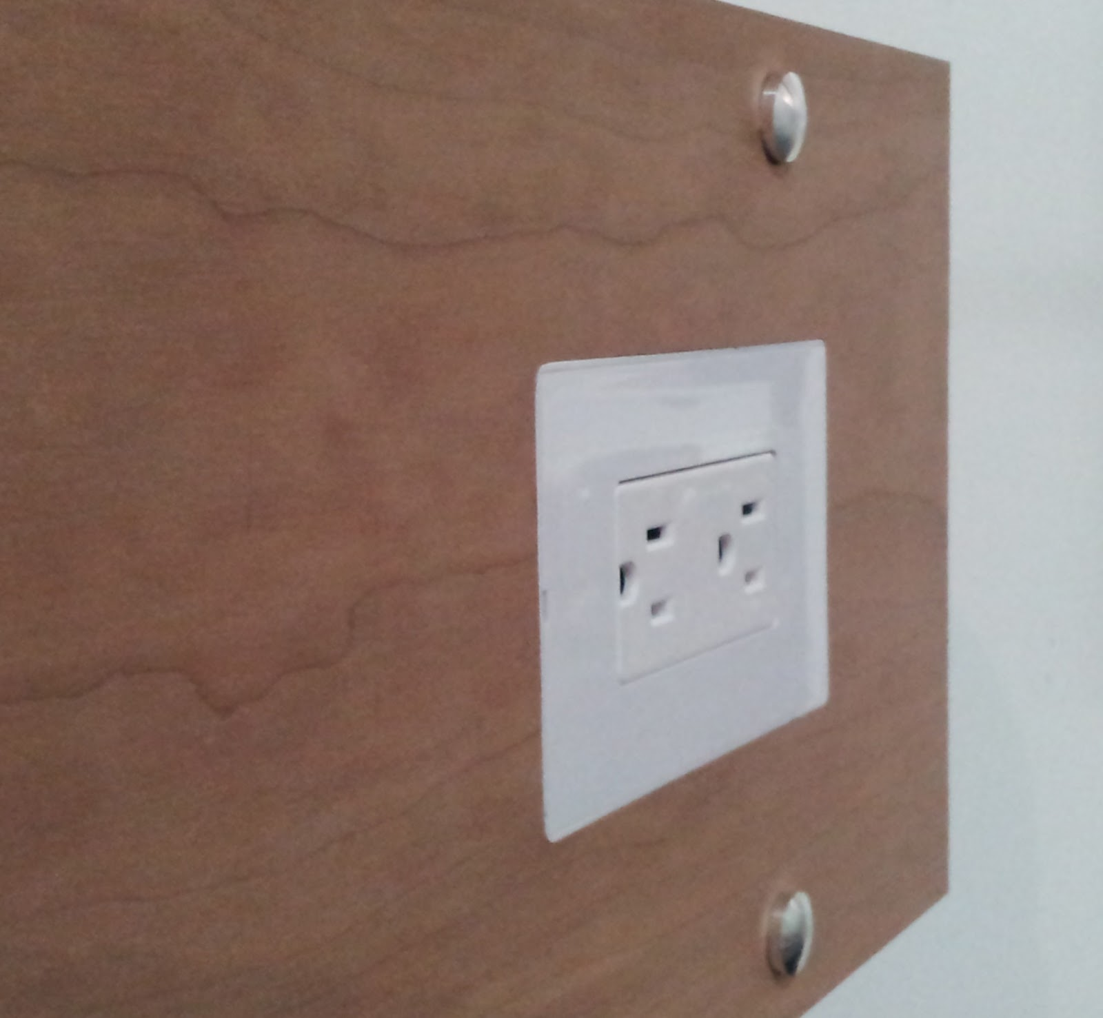 Smoothline flush-mount outlet cover for wood