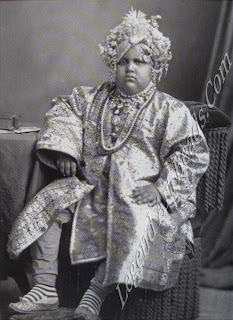 Jagatjit Singh. Maharaja of Kaptirthala aged about 15. in traditional court dress and jewels. The camera gives no clue that the pudgy prince was to mature into an elegant, globe-trotting aesthete and ardent Francophile.