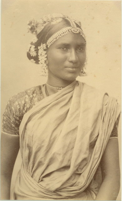 Portrait of an Indian Woman. Her Hair Decorated with Flowers and Ornaments - c1880