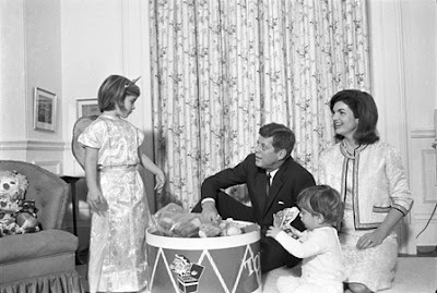 President JFK, Jackie, Caroline, and John Jr playing in the White House