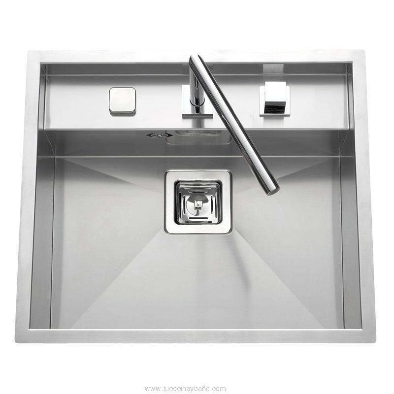 Fregadero bajo ventana cocina