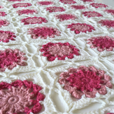 http://www.ravelry.com/patterns/library/bed-of-flowers-baby-blanket