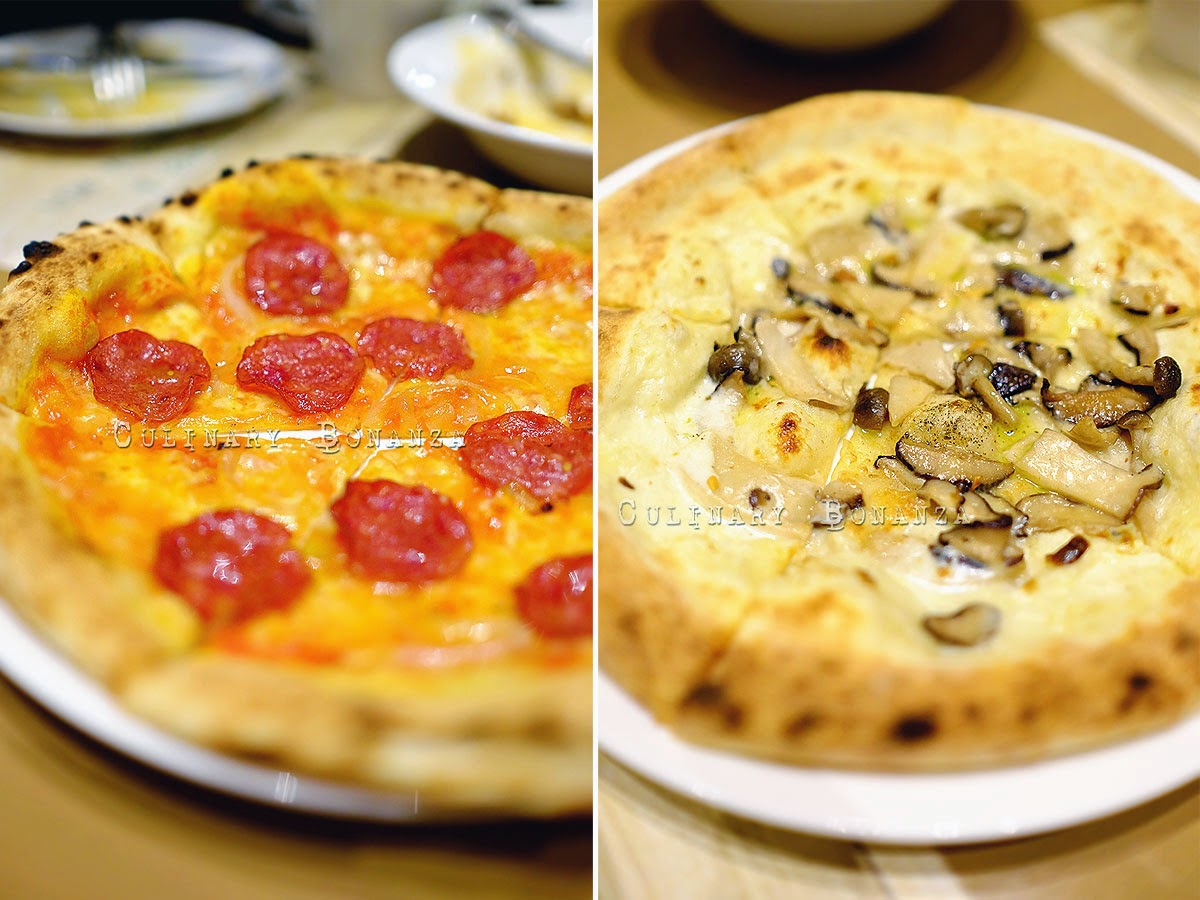 Left: Beef Pepperoni Pizza IDR 60,000 Right: Three Japanese Mushroom Pizza IDR 65,000