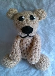http://www.ravelry.com/patterns/library/berry-the-tiny-bear