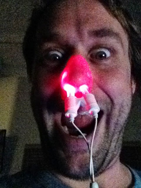 Man with glowing red nose from using Sneezer Beam