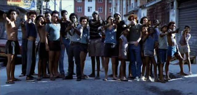 city of god 2002 represents violence City of god was, and is, a place of endless violence mob bosses have way more power in the favela of rio de janeiro than brazilian government and they change on a weekly basis as a younger gangster decides to kill the old boss.