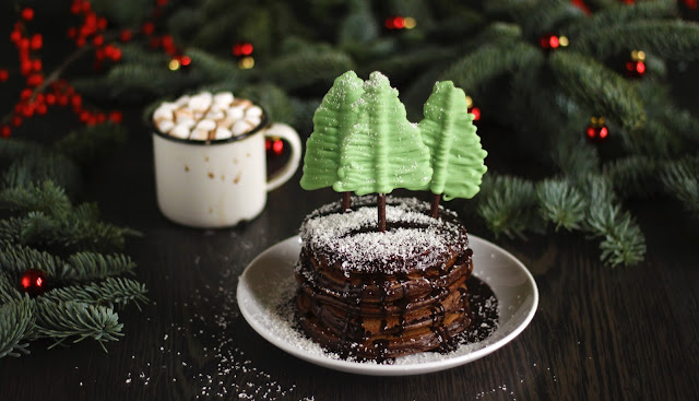 A Xmas special! Super chocolatey pancakes covered with fudgy chocolate sauce with chocolate trees and -  you guessed it - hot drinking chocolate! This festive recipe is brought to you by the German food blog Pancake Stories!
