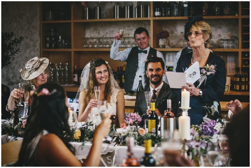 Wedding guests toasting at River Cottage HQ