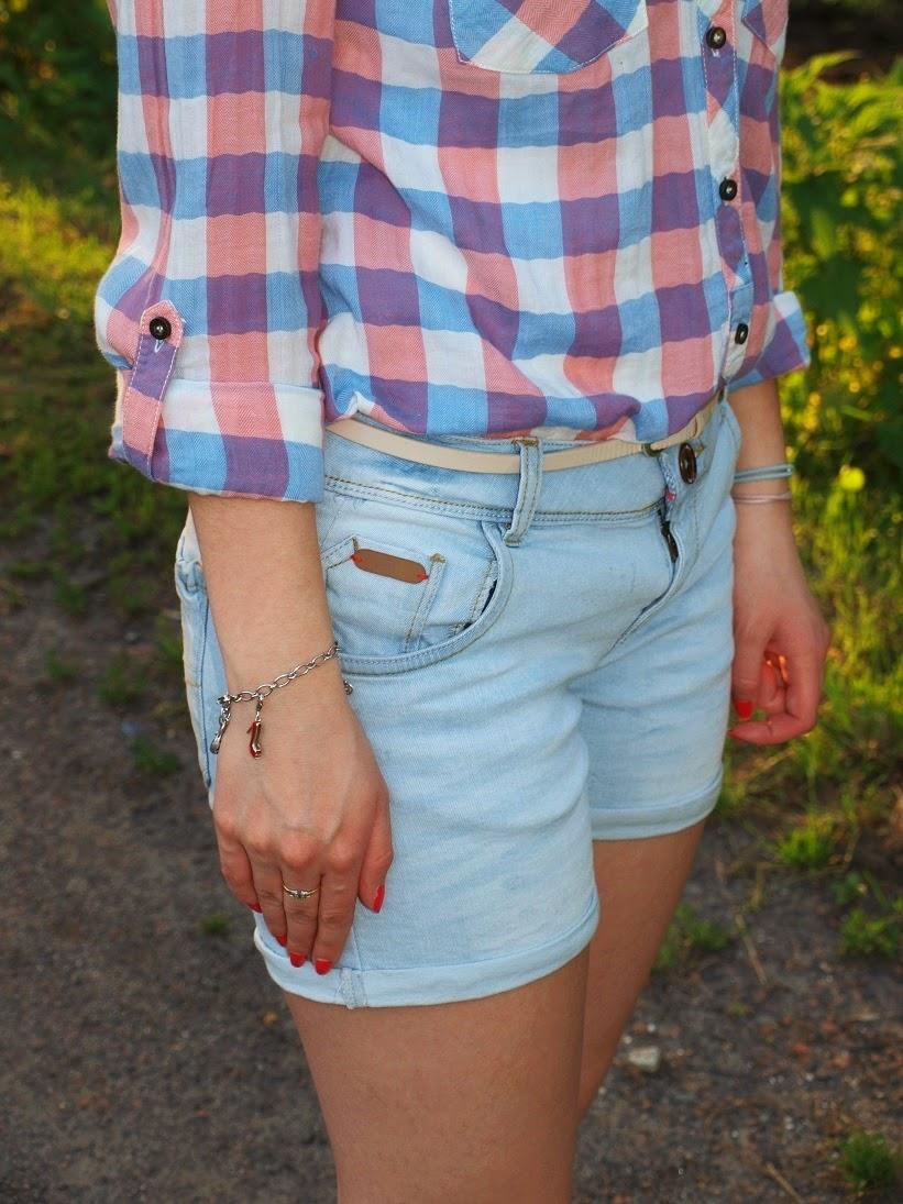 Checkered shirt and denim shorts