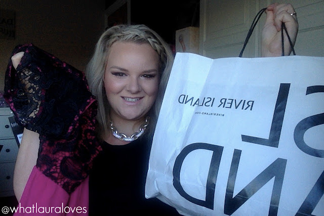 Blogger what laura loves holding up a pink dress from yours clothing and a bag of clothes from river island