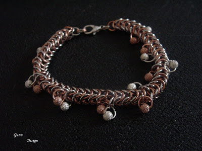 Chainmaille bracelet with small bead charms.