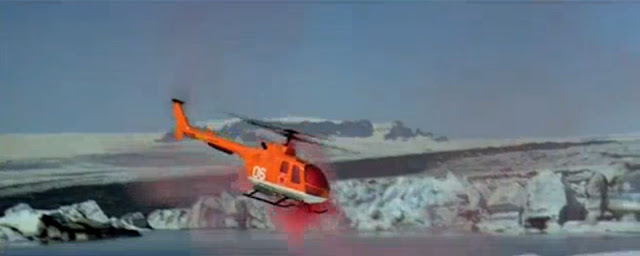 A View To A Kill, James Bond. Orange Communist helicopter spinning out of control as orange smoke pours out of the cabin. Orange smoke bomb, smoke grenade, distress flare, smoke flare