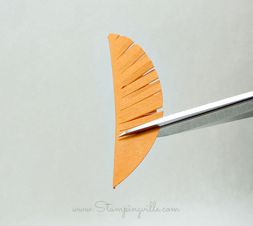 For a feather, make snips at an angle and close together