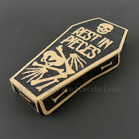 http://paperzen.blogspot.ca/2013/09/printable-halloween-skeleton-coffin.html