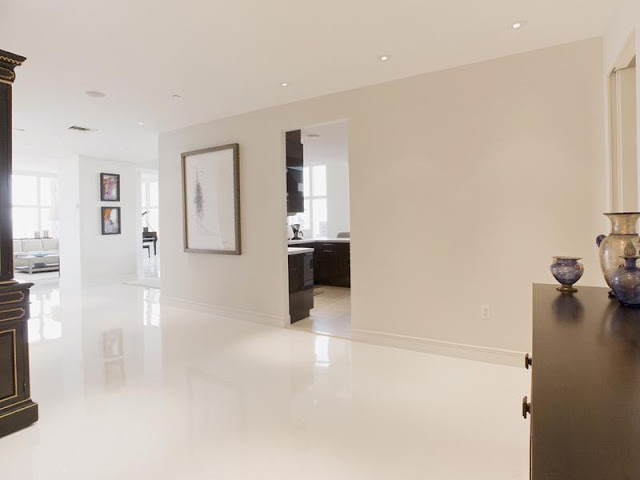 Photo of clean white hallway in New York penthouse