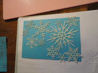 Turquoise background with snowflakes stencils