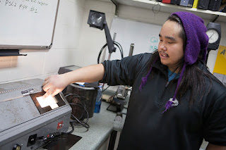Trenton Coopchiak shows a slide of a step calibration during one of his NDT classes. (Photo by Philip Hall/University of Alaska Anchorage)
