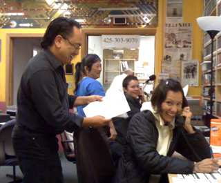 KSER volunteers take calls during a pledge drive.