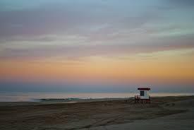 atardecer en playa cariló
