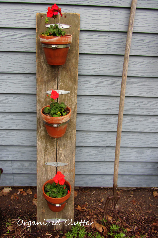 Terracotta Pot Planter from Reclaimed Wood www.organizedclutterqueen.blogspot.com