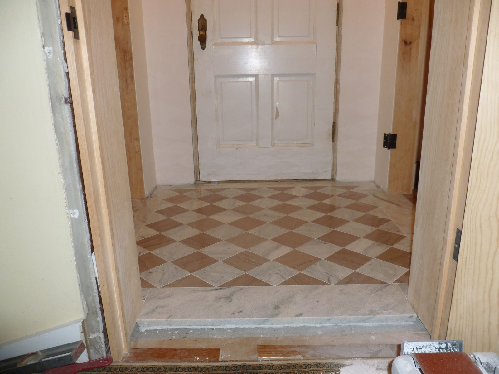 Handyman in the iowa illinois quad cities installing a very the completed marble floor tile installation without the marble plinth blocks or marble baseboards installed dailygadgetfo Gallery