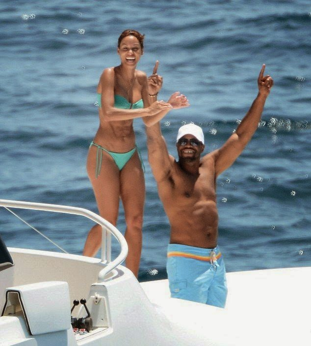 Nicole Murphy is sensational in a Turquoise Bikini as she jumps to sea in St. Barts