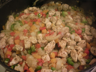 Coloful peppers and chicken cooking