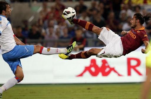 AS Roma striker Pablo Osvaldo shoots to score with a sensational scissor-kick against Catania