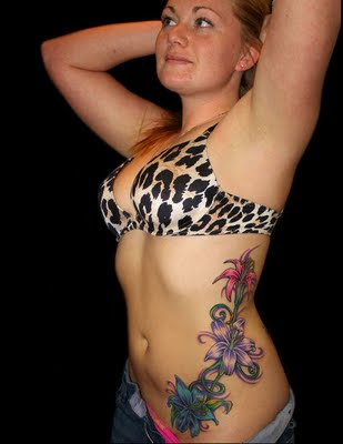 side tattoos for girls. side tattoos. tattoo girls