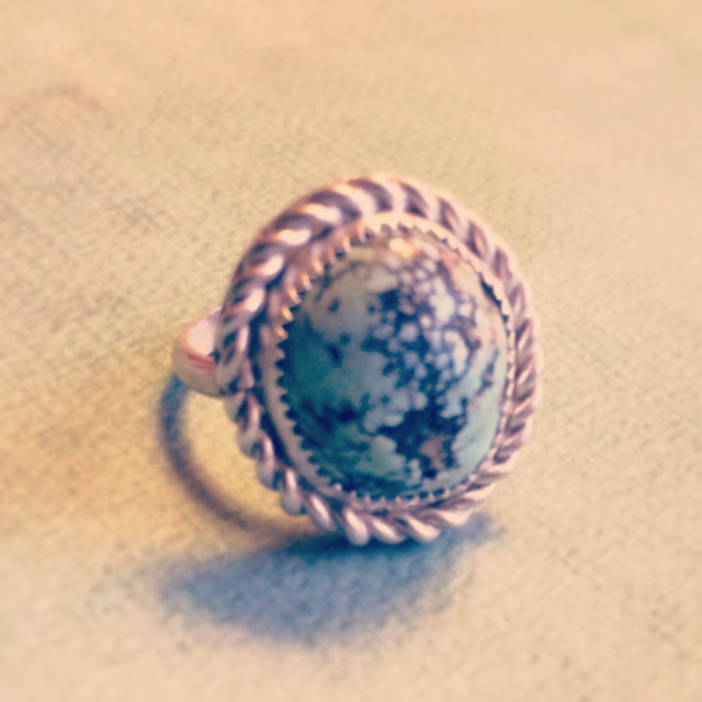 Silver ring with twisted wire around a turquoise robin's egg blue stone
