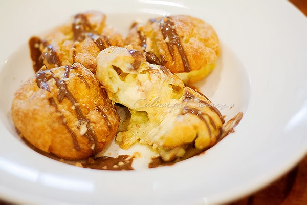 Profiteroles - French puff pastry with vanilla gelato, home made chocolate sauce and crushed almonds
