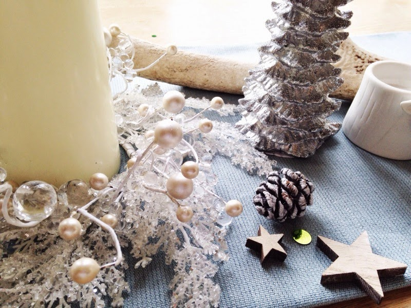 Christmas table decoration with candles and pinecones
