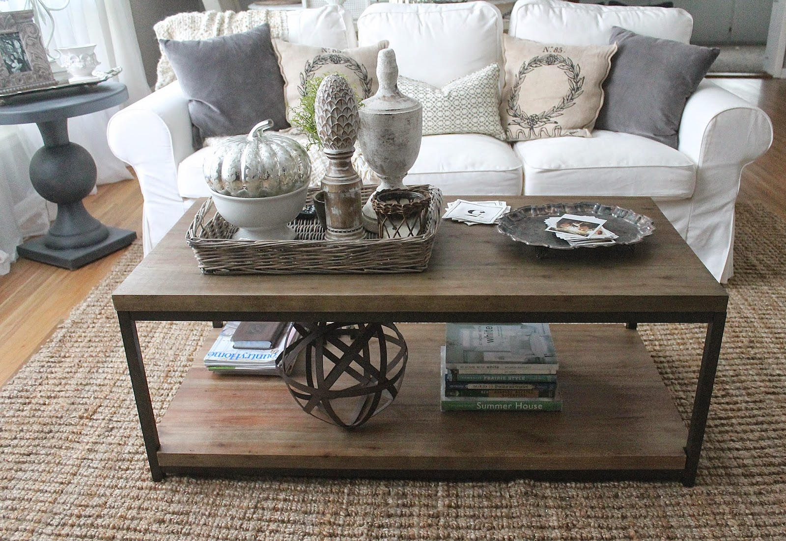 This Is How Our Living Room Coffee Table Looks On A Daily Basis It Has Some Of My Very Favorite Accessories Gray Wicker Tray Few Large Finials