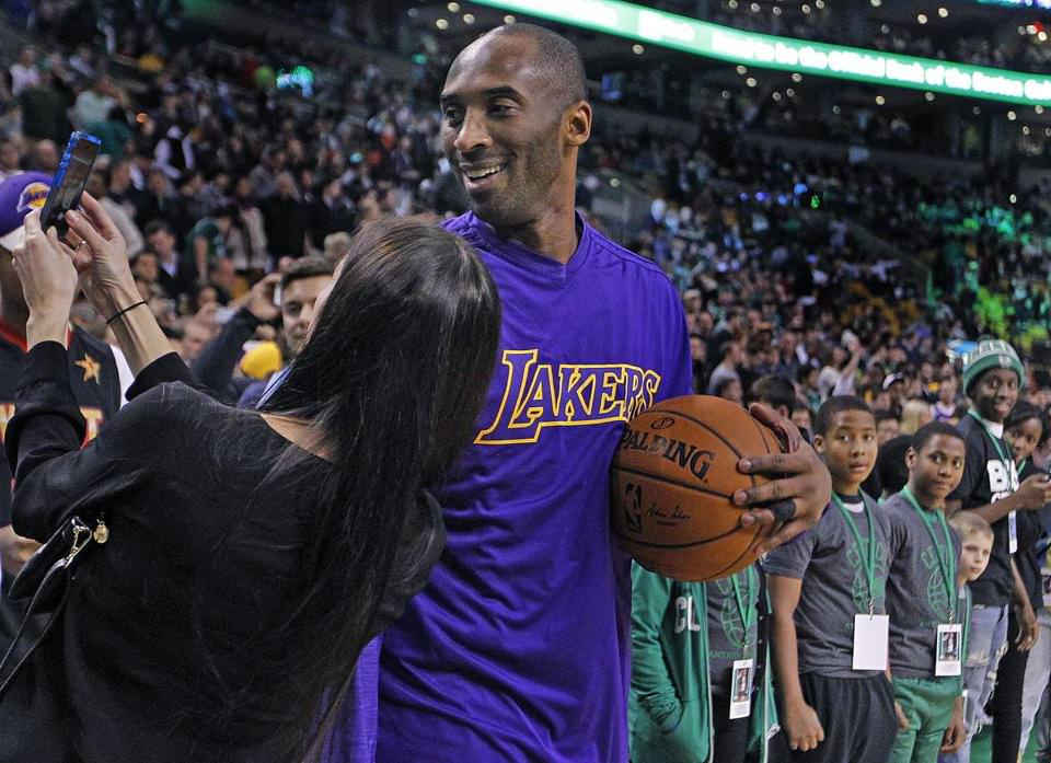 Lakers star Kobe Bryant obliged a fan with a courtside selfie during pregame warmups