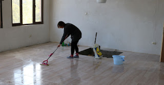 Mopping the grout from off the tiles