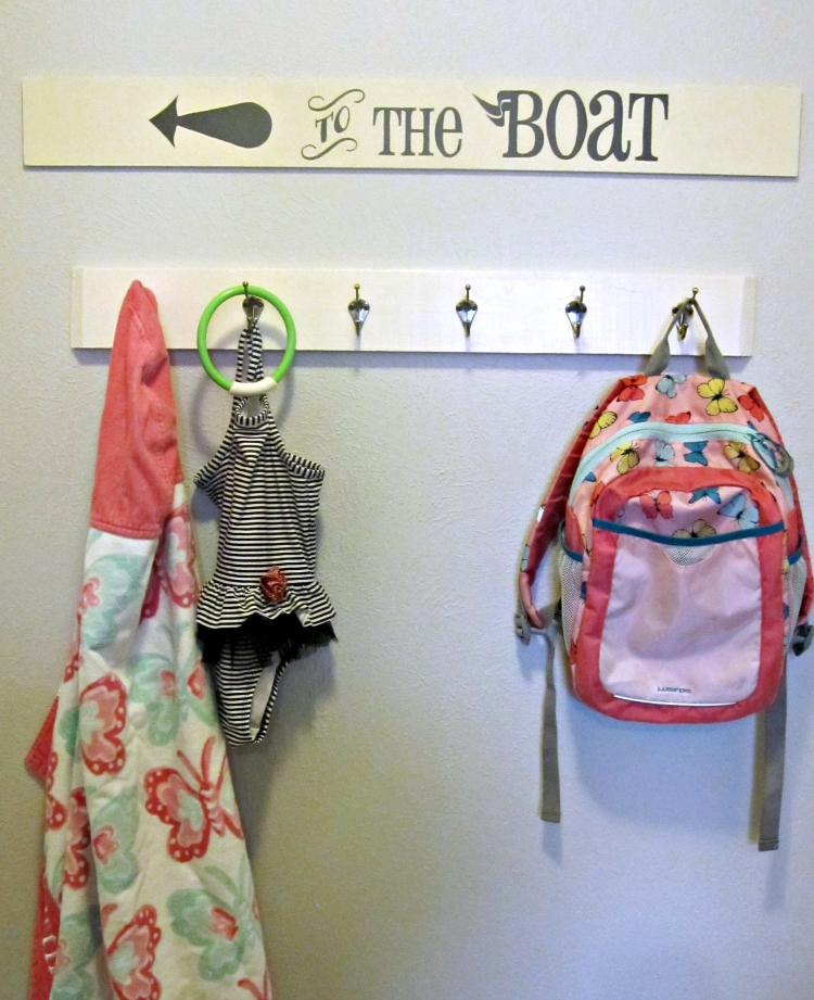 Hand painted sign above coat hooks
