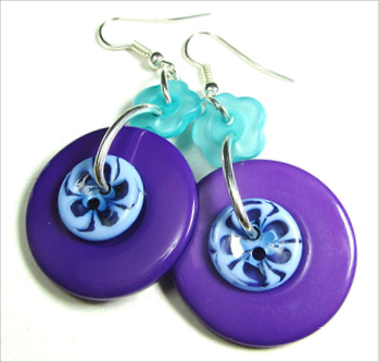 Edgy drop earrings have big purple buttons hanging from teal flower buttons