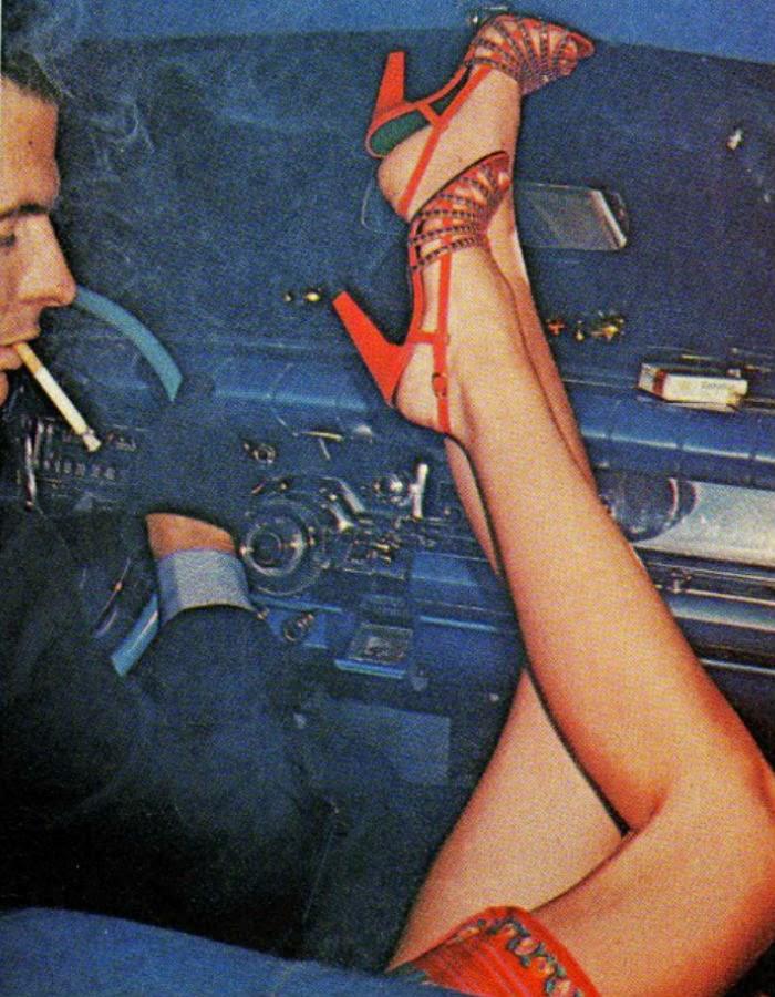 Women's legs in a car