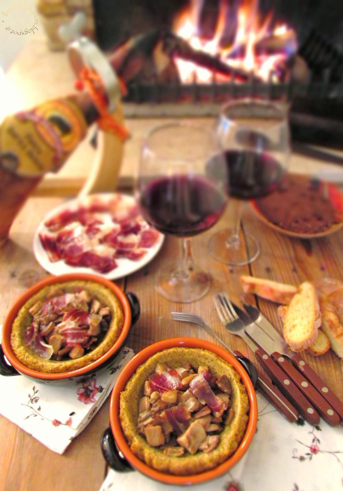italia - spagna. polenta taragna con funghi e riccioli croccanti di pata negra